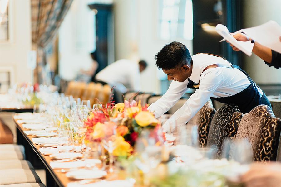 waiters setting up beautiful large table